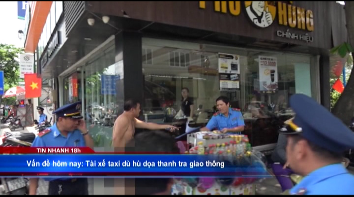 Tài xế taxi dù hù dọa thanh tra giao thông